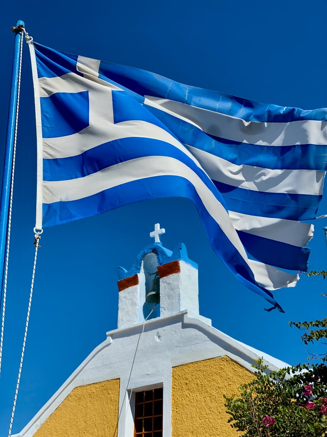 greek flag church unsplash